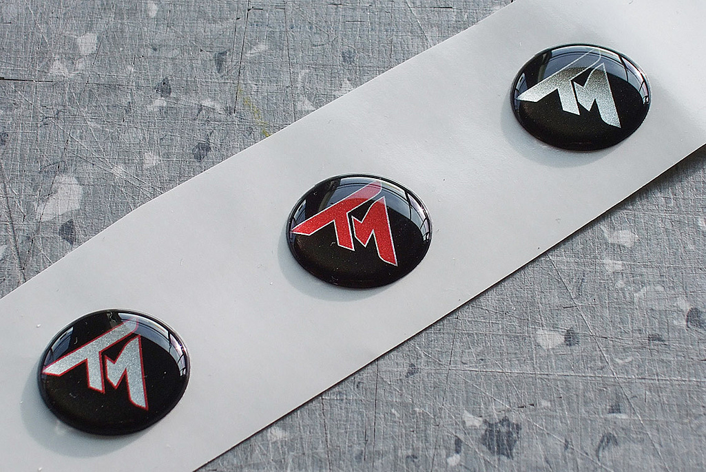 Click image for larger version.  Name:T300RS new BADGE SAMPLES.jpg Views:4 Size:251.2 KB ID:204948